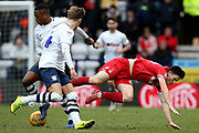 Nottingham Forest midfielder Joe Lolley (23) is upended in the challenge with Preston North End defender Darnell Fisher (2) during the EFL Sky Bet Championship match between Preston North End and Nottingham Forest at Deepdale, Preston, England on 16 February 2019.