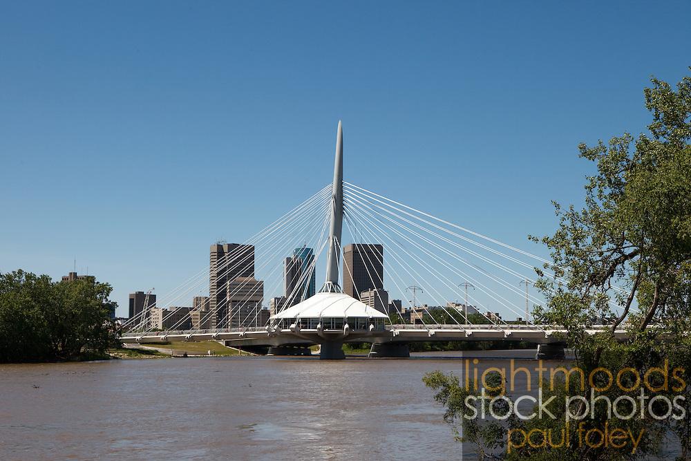 Saint-Boniface / Broadway Bridge with Winnipeg city scape, Canada.
