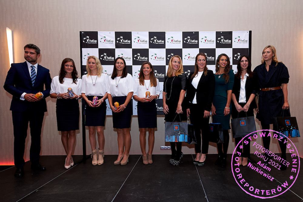 (L-R) Tomasz Wiktorowski and Agnieszka Radwanska and Urszula Radwanska and Klaudia Jans Ignacik and Alicja Rosolska all from Poland and Svetlana Kuznetsova and Anastasia Pavyuchenkova and Vitalia Diatchenko and Anastasia Myskina and Maria Sharapova all from Russia pose to images during official dinner two days before the Fed Cup / World Group 1st round tennis match between Poland and Russia at Holiday Inn on February 5, 2015 in Cracow, Poland.<br /> <br /> Poland, Cracow, February 5, 2015<br /> <br /> Picture also available in RAW (NEF) or TIFF format on special request.<br /> <br /> For editorial use only. Any commercial or promotional use requires permission.<br /> <br /> Adam Nurkiewicz declares that he has no rights to the image of people at the photographs of his authorship.<br /> <br /> Mandatory credit:<br /> Photo by &copy; Adam Nurkiewicz / Mediasport