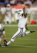 New York Jets kicker Jay Feely (3) kicks a 49 yard second quarter field goal that gives the Jets a 6-3 lead during the NFL football game against the Buffalo Bills, December 3, 2009 in Toronto, Canada. The Jets won the game 19-13. ©Paul Anthony Spinelli