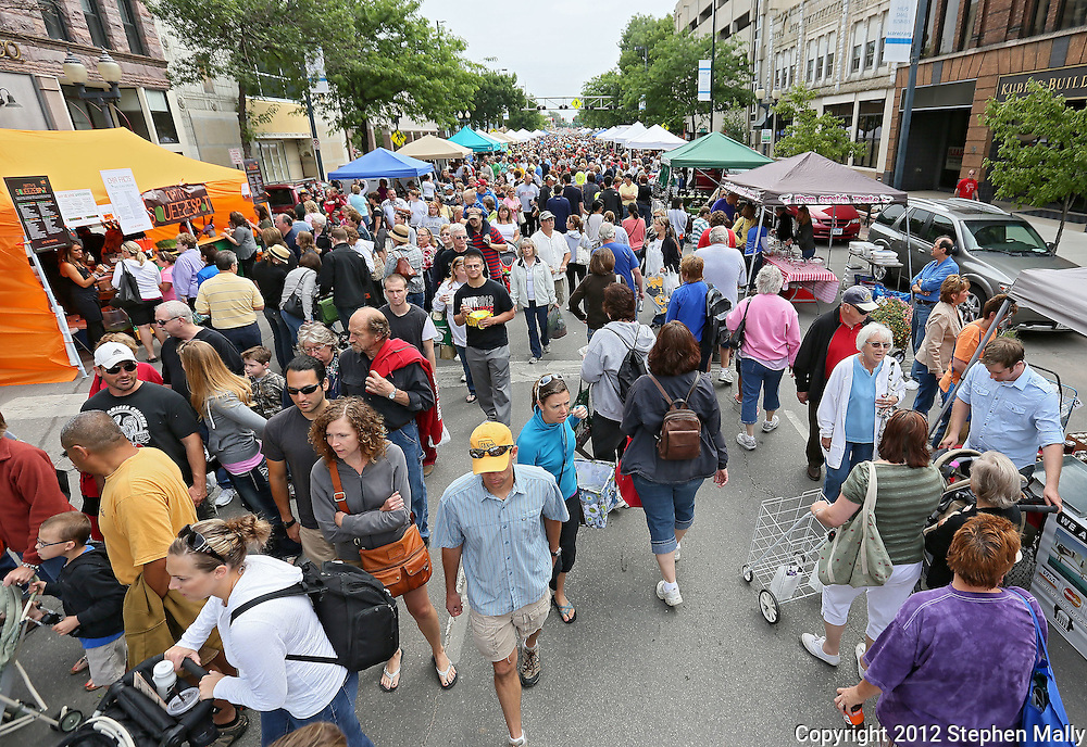 People walk down 3rd Avenue at the Downtown Farmers' Market in Cedar Rapids on Saturday morning, June 2, 2012. There were 244 vendors who participated in the first market of the year. (Stephen Mally/Freelance)