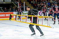 KELOWNA, CANADA - DECEMBER 27: Ice crew member, Devon Craig skates with the ladder after making repairs to the glass on December 27, 2016 at Prospera Place in Kelowna, British Columbia, Canada.  (Photo by Marissa Baecker/Shoot the Breeze)  *** Local Caption ***