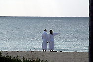 A couple enjoys an early morning on a beach near Freeport, Bahamas
