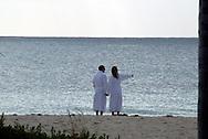 A couple enjoys an early morning on a beach near Freeport, Bahamas