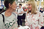 "Sept. 27 - PHOENIX, AZ: JACKIE, (left) a diner at the St. Vincent de Paul lunch service, talks to CAROL PICCO, a volunteer, after lunch Monday, Sept. 27. September 27, 2010 is the 350th Feast Day of Saint Vincent de Paul, also known as the ""Apostle of Charity."" To mark the day, the Society of St. Vincent de Paul in Phoenix served birthday cake during the lunch service. The US Census office recently announced that poverty in the US has spiked to 14.3% of the population, the highest poverty rate since 1994. Officials at St. Vincent de Paul in Phoenix said that demand for their services have increased steadily in the last three years. They currently feed about 1,100 people, either homeless or members of the working poor, every day.    Photo by Jack Kurtz"