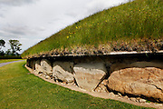 Detail of Kirbstones, Great Mound, Knowth, c. 3000 BC, Bru na Boinne, County Meath, Ireland, in the evening. The megalithic Great Mound was probably built after Newgrange and before Dowth. Similar in size to Newgrange it is surrounded by 18 smaller satellite mounds and has two passages. Picture by Manuel Cohen