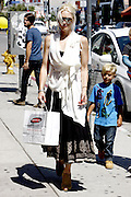 02.JULY.2011. LOS ANGELES<br /> <br /> GWEN STEFANI AND HUSBAND GAVIN ROSSDALE TOOK THEIR SONS KINGSTON AND ZUMA PLAYED ON A DRUMSET AT A SHOE STORE AND THEN GOT A COOL BLUE HAIR DYE MOHAWK HAIRCUTS IN LOS ANGELES, CALIFORNIA.<br /> <br /> BYLINE: EDBIMAGEARCHIVE.COM<br /> <br /> *THIS IMAGE IS STRICTLY FOR UK NEWSPAPERS AND MAGAZINES ONLY*<br /> *FOR WORLD WIDE SALES AND WEB USE PLEASE CONTACT EDBIMAGEARCHIVE - 0208 954 5968*