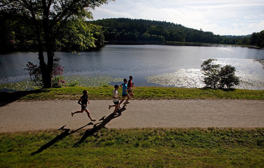 Zap Fitness athletes go through a training run in the morning around Bass Lake at Moses H. Cone Memorial Park in Boiling Rock, NC.