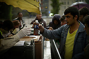 [English]  A young afghan refugee is coming to get some hot tea distributed around the Jaunr&egrave;s metro station by the French NGO &quot;L'armee du Salut&quot;. <br /> <br /> [Francais] Un jeune migrant afghan vient chercher du the chaud aupres des benevoles de l'Armee du Salut pres du metro Jaures.
