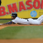 Derek Jeter, New York Yankees, dives into second base on a double during the fifth inning during the New York Yankees V Baltimore Orioles home opening day at Yankee Stadium, The Bronx, New York. 7th April 2014. Photo Tim Clayton