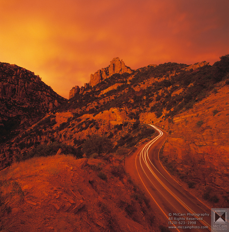 Mount Lemmon Highway: near milepost 9, sunset after storm, very red light from clouds, Mount Lemmon, Santa Catalina Mountains, Coronado National Forest, Arizona..Media Usage:.Subject photograph(s) are copyrighted Edward McCain. All rights are reserved except those specifically granted by McCain Photography in writing...McCain Photography.211 S 4th Avenue.Tucson, AZ 85701-2103.(520) 623-1998.mobile: (520) 990-0999.fax: (520) 623-1190.http://www.mccainphoto.com.edward@mccainphoto.com