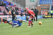 Wigan Athletic Midfielder, Chris McCann and Oldham Athletic Defender, Cameron Dummigan clash at the touch line during the Sky Bet League 1 match between Wigan Athletic and Oldham Athletic at the DW Stadium, Wigan, England on 13 February 2016. Photo by Mark Pollitt.