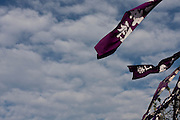 Large flags fly over the ceremonial ground during the Hamaorisai Matsuri that takes place on Southern Beach in Chigasaki, near Tokyo, Kanagawa, Japan Monday July 20th 2009. The festivals marks the celebration of Marine Day and the rescuing of a divine image that was washed ashore in the area. Over thirty Mikoshi or portable shrines are carried through the night from surrounding shrines to arrive on the beach for sunrise. There they are blessed and then carried into the surf to purify them.