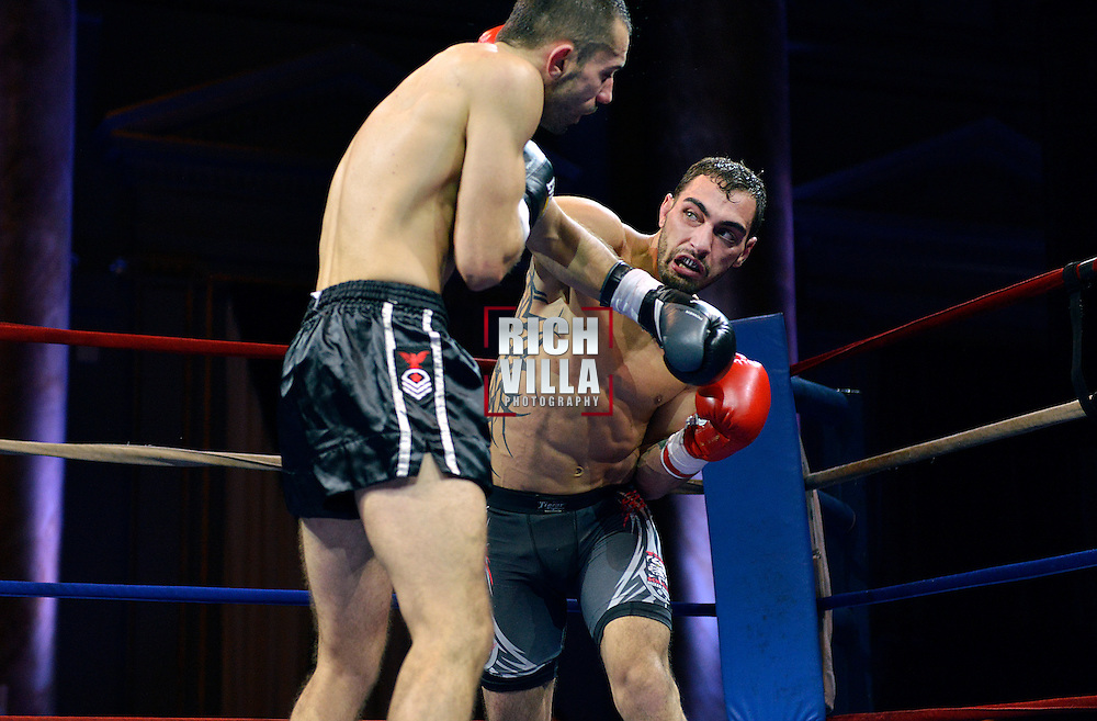 Nick Pace(Right) lands a right over hand on Niko Tsigaras(Left) at Combat at the Capitale event at the Capitale Theater in New York City on September 27, 2013