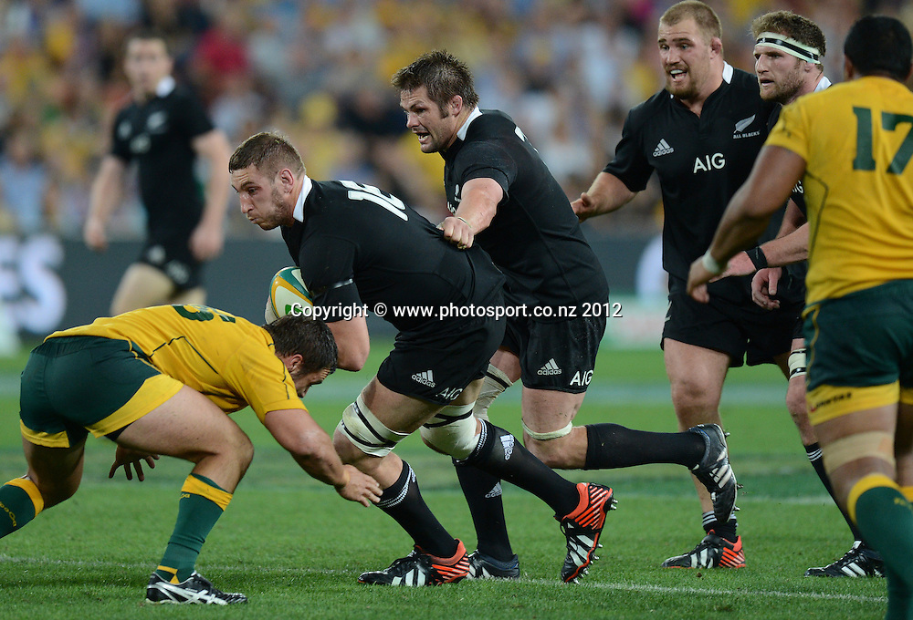 Luke Romano takes the ball forward supported by Richie McCaw. The Rugby Championship and Bledisloe Cup test match, Australain Wallabies v New Zealand All Blacks, Suncorp Stadium, Brisbane, Saturday 20 October 2012. Photo Credit: Andrew Cornaga/Photosport.co.nz