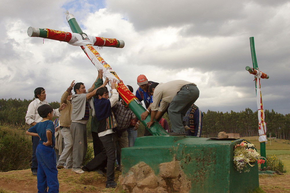 Men raising huge cross during Fiesta de Cruz, Cuzco, Peru, South America