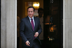 © Licensed to London News Pictures. 01/12/2015. London, UK.  Prime Minister DAVID CAMERON comes out of 10 Downing Street to meet with Britain's winning Davis Cup team. Photo credit: Peter Macdiarmid/LNP