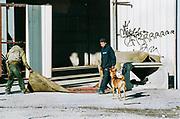 Men and dog in car park at NYE party, France December 2011