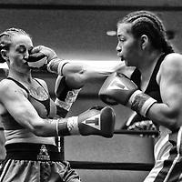 DAYTONA BEACH, FL - FEBRUARY 08:  Rebecca Cruz (R) punches Elizabeth Tuani during their boxing match at Hard Rock Hotel Daytona on February 8, 2020 in Daytona Beach, Florida. (Photo by Alex Menendez/Getty Images) *** Local Caption *** Rebecca Cruz; Elizabeth Tuani