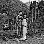 """Ernesto Ezpeleta """"Bihurri"""", wood cutter or aizkolari in Basque language, with his son Odehi near his home in Mendaro. Basque rural sports (Herri Kirolak in basque language) are rooted in traditional lifestyles, mostly farmer occupations of the Basque Country, in Northern Spain. Nowadays they have transform themselves into sports based in strenght and skill. Stone lifting and wood chopping are the most popular."""
