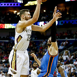 Jan 25, 2017; New Orleans, LA, USA; New Orleans Pelicans forward Donatas Motiejunas (12) shoots over Oklahoma City Thunder center Steven Adams (12) during the second half of a game at the Smoothie King Center. The Thunder defeated the Pelicans 114-105. Mandatory Credit: Derick E. Hingle-USA TODAY Sports