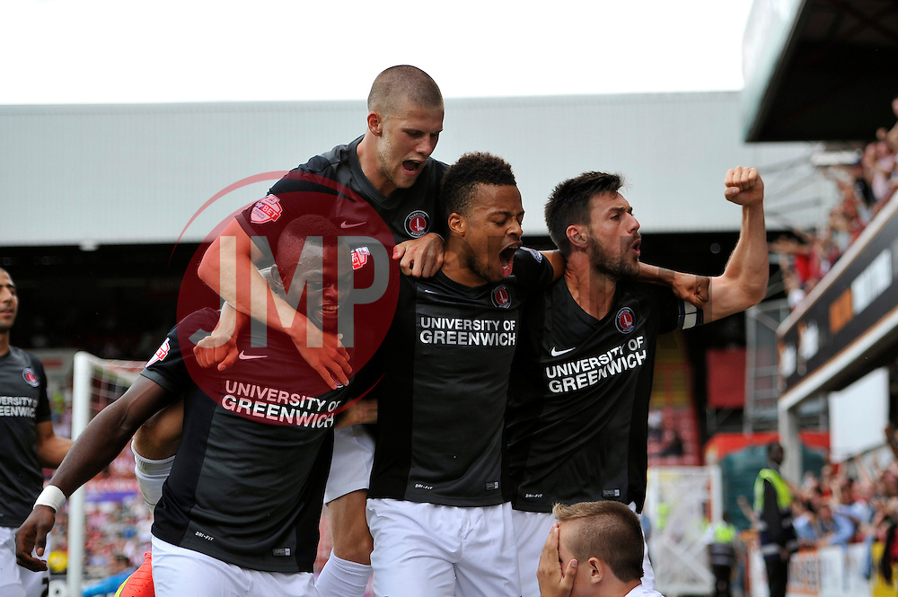 Charlton players celebrate Charlton Athletic's Igor Vetokele's second half goal - Photo mandatory by-line: Patrick Khachfe/JMP - Mobile: 07966 386802 09/08/2014 - SPORT - FOOTBALL - Brentford - Griffin Park - Brentford v Charlton Athletic - Sky Bet Championship - First game of the season