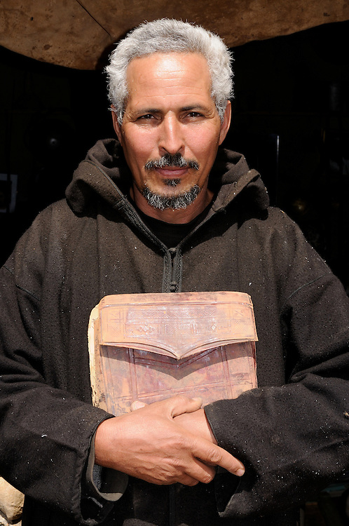 Man holding old manuscripts of the holy Koran, Ouadane, Western Africa, Mauretania, Africa