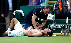 Russia's Mikhail Kukushkin receives a medical timeout during day five of the Nature Valley International at Devonshire Park, Eastbourne.
