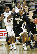 26 NOVEMBER 2007: Wake Forest guard Jeff Teague (0) breaks down court in Wake Forest's 56-47 win over Iowa at Carver-Hawkeye Arena in Iowa City, Iowa on November 26, 2007.