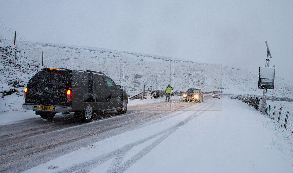 © Licensed to London News Pictures. 27/01/2012. Derbyshire, UK. Drivers struggle with the impact of a severe snowfall along Derbyshire's notorious Snake Pass Road. Photo credit : Joel Goodman/LNP