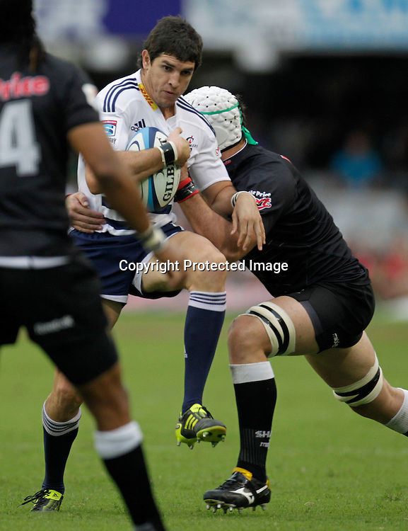 Stormers centre Jaque Fourie is tackled by Sharks player Alistair Hargreaves  during a Super 15 rugby match in Durban, 2 April , 2011. Sportzpics