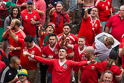 LILLE, FRANCE - Friday, July 1, 2016: Wales fans sing as they gather in the centre of Lille ahead of the UEFA Euro 2016 Championship Quarter-Final match against Belgium at the Stade Pierre Mauroy. (Pic by Paul Greenwood/Propaganda)