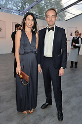 EMILY SHEFFIELD and her husband TOM MULLION at British Vogue's Centenary Gala Dinner in Kensington Gardens, London on 23rd May 2016.