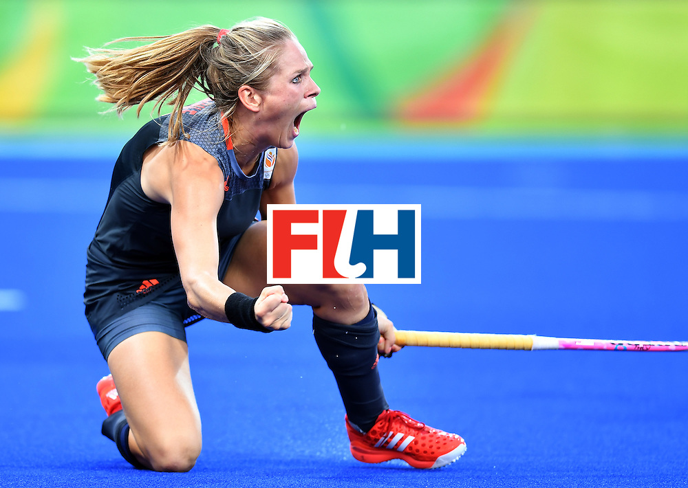 Netherlands' Kitty van Male celebrates scoring a goal during the women's Gold medal hockey Netherlands vs Britain match of the Rio 2016 Olympics Games at the Olympic Hockey Centre in Rio de Janeiro on August 19, 2016. / AFP / MANAN VATSYAYANA        (Photo credit should read MANAN VATSYAYANA/AFP/Getty Images)