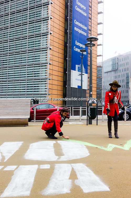 Brussels Belgium 26 Oktober 2016 while the Belgian government negotiated on the CETA deal, Pro CETA Canadians add the W on the  chalked protests against CETA in front of the European Commision in Brussels.
