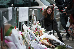 © London News Pictures. 14/11/2015. A woman laying flowers near Bataclan theatre  the day after multiple terror attacks on the French capital. Photo credit: Guilhem Baker/LNP