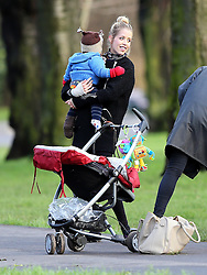 A glowing Peaches Geldof who is pregnant with her second child, takes her son Astala and dog Parpy to a trip the park. Astala wearing an Owl hat, blue woolly top, stripy leggings with the words Cuty Baby on the back seemed to be enjoying himself as his mum spun him around. Peaches met up with a friend for a chat before heading home.... London, UK. 01/02/2013<br />BYLINE MUST READ : JAMESY/GOTCHA IMAGES<br /><br />Copyright by © Gotcha Images Ltd. All rights reserved.<br />Usage of this image is conditional upon the acceptance <br />of Gotcha Images Ltd, terms and conditions available at<br />www.gotchaimages.com