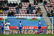 Wigan Athletic forward Kieffer Moore (19) sends Swansea City goalkeeper Freddie Woodman (27) the wrong way as he scores the penalty 1-1  during the EFL Sky Bet Championship match between Wigan Athletic and Swansea City at the DW Stadium, Wigan, England on 2 November 2019.