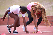 CAPE TOWN, SOUTH AFRICA - MARCH 10: Natasha Hastings shows a young athlete some start drills during the TrackGirlz events at University of Western Cape on March 10, 2018 in Cape Town, South Africa. (Photo by Roger Sedres/ImageSA)