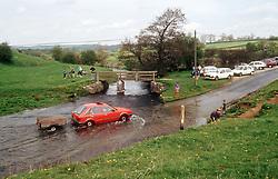 Car driving through flood water in Derbyshire,