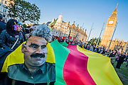 A protest demanding support for the Kurds and blaming Turkey for not helping is generally peaceful. Although a bungled stop and search kicks off a confrontation that leads to a few arrests. Calm is restored, at least temporarily when Kurdish stewards form a barrier between the protestors and the police lines. Parliament Square, London 11 Oct 2014.