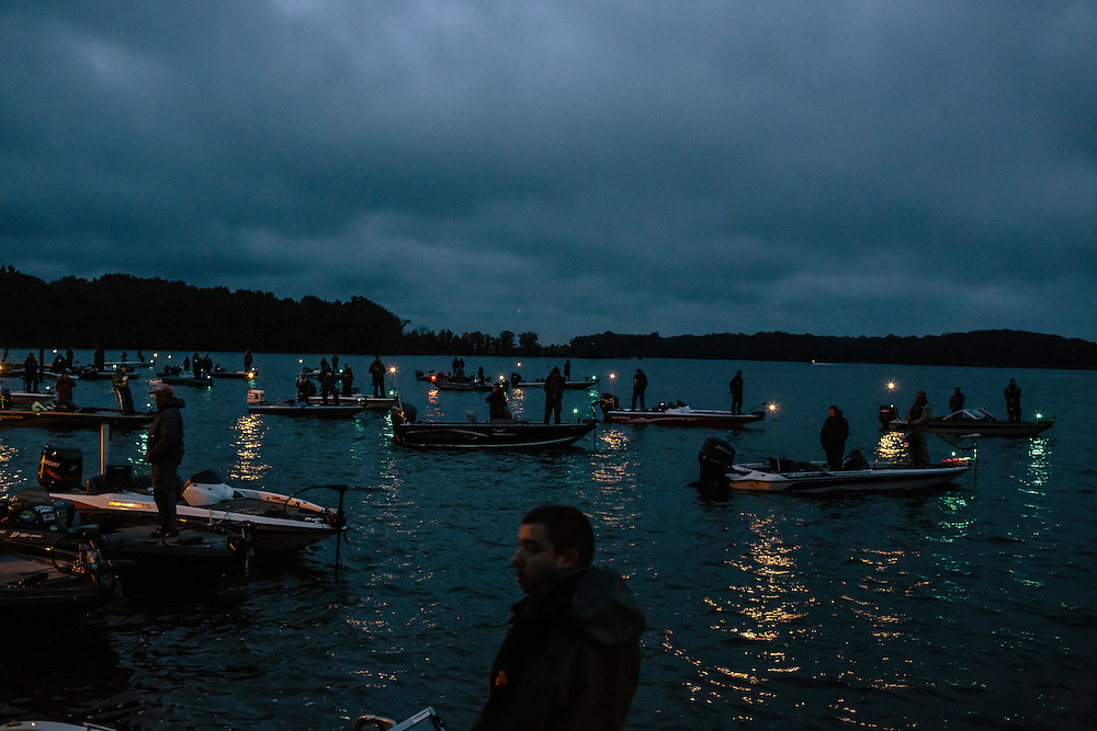 Teams, including Ricky Lee, center, of State University of New York -Plattsburgh, prepare for the start of the competition during the FLW College Fishing Northern Conference Invitational in Marbury, MD on Oct. 11, 2014. Only the top 15 of 43 teams moved on to Sunday.