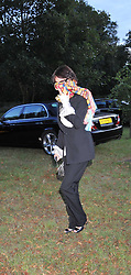 LUCY BIRLEY at a Summer party hosted by Lady Annabel Goldsmith at her home Ormeley Lodge, Ham, Surrey on 14th July 2009.
