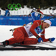 Winter Olympics, Vancouver, 2010.Ann Kristin Aafedt Flatland, who finished tenth, feels the pain at the end of  the Women's 7.5 KM Sprint Biathlon at The Whistler Olympic Park, Whistler, during the Vancouver  Winter Olympics. 13th February 2010. Photo Tim Clayton