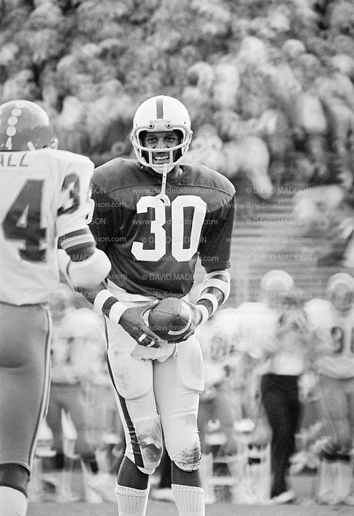 PALO ALTO, CA -  NOVEMBER 12:  Wide receiver James Lofton #30 of Stanford University smiles after making a catch during an NCAA football game against the San Jose State Spartans played November 12, 1977 at Stanford Stadium on the campus of Stanford University in Palo Alto, California.  Lofton later played in the NFL and is a member of the Pro Football Hall of Fame. (Photo by David Madison/Getty Images) *** Local Caption *** James Lofton