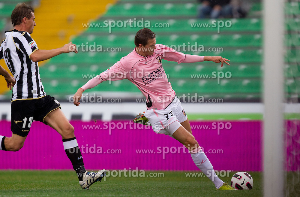 Andrea Coda of Udinese vs Josip Ilicic of Palermo during football match between Udinese Calcio and Palermo in 8th Round of Italian Seria A league, on October 24, 2010 at Stadium Friuli, Udine, Italy.  Udinese defeated Palermo 2 - 1. (Photo By Vid Ponikvar / Sportida.com)
