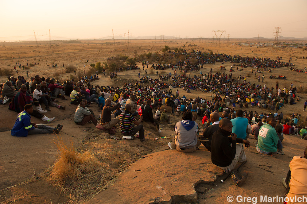 Lonmin employees gather on a hill called Wonderkop at Marikana, outside Rustenburg in the North West Province of South Africa August 15. The miners are calling for the minimum wage to be lifted from its current R4,000 a month to R12,500. The men are mostly Xhosa and Pondo speaking, and the strike was initiated by the drillers. Photograph Greg Marinovich