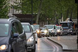 © Licensed to London News Pictures. 28/04/2020. London, UK. Traffic on the Embankment in Westminster today. London has also seen an increase in traffic and busier High Streets as more shops and cafes start to open up during the coronavirus pandemic crisis. Photo credit: Alex Lentati/LNP