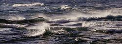 Waves churn offshore at Lae o Kaonohi near the Hanalei Colony Resort on north shore of the island of Kauai in Hawaii.