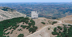 November  1, 2018 - Sicily - ESA's plans to deploy a network of asteroid-detecting 'Flyeye' telescopes has come one step closer to reality. Last week, the Agency signed an agreement with the Italian Space Agency (ASI) to locate the first-ever Flyeye telescope atop the 1865-metre Monte Mufara mountain in Sicily. The revolutionary Flyeye design is similar to that of a fly's compound eye - it uses multiple cameras and optics, splitting a section of the sky into 16 smaller images, to expand the telescope's field of view. This telescope, nestled within the building in the artist's illustration above, will be the first in a potential network of four telescopes across the globe, that together will have the ability to run nightly surveys of the entire sky, automatically scanning for near-Earth objects, potentially hazardous space rocks that could impact our planet. (Credit Image: © ESA/ZUMA Wire/ZUMAPRESS.com)
